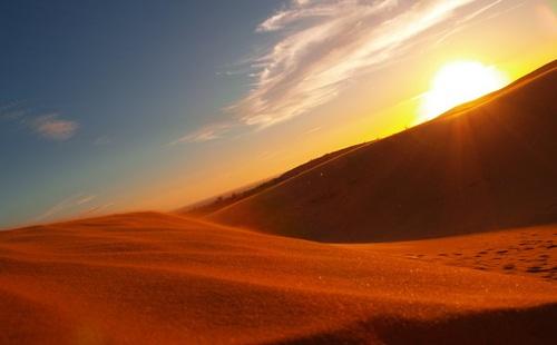 Sunrise in Red sand dunes
